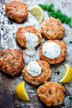 Salmon Cakes Turn left-over cooked salmon into elegant crispy salmon cakes with lemon zest, capers and light tartar sauce made with Greek yogurt. They're ready in less than a half hour! - Lemon Caper Salmon Cakes with Light Tartar Sauce Fish Dishes, Seafood Dishes, Fish And Seafood, Seafood Appetizers, Sauce Recipes, Cooking Recipes, Healthy Recipes, Vegaterian Recipes, Healthy Dishes