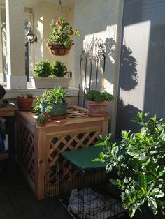 Michael made this beautiful AC cover. A nice place to add a few plants without them affecting the unit's performance.