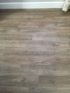 Our floors love them!  NuCore Driftwood Oak waterproof Vinyl luxury Plank with Cork Back Also anti-microbial