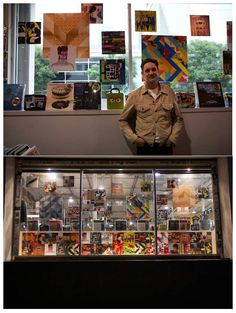 FIDM Graphic Design Instructor Graham Moore with his album cover collage art on display in the window of Amoeba Hollywood.