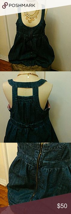 Denim Bubble Hem Dress Rigid denim with exposed zipper front closure. Cute design in back with bow at waist. Boom Boom Jeans Dresses Mini