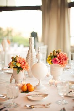 love the textured white vases together with all white linens and bright flowers