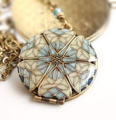 Love vintage looking lockets.  These ones designed by MStevensonDesigns (on Etsy) are perfect!  $70-90.