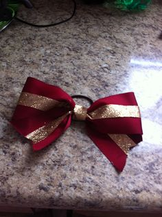 Awesome maroon and gold cheer bow that costs $8.00 bow made by Traci Torrenti