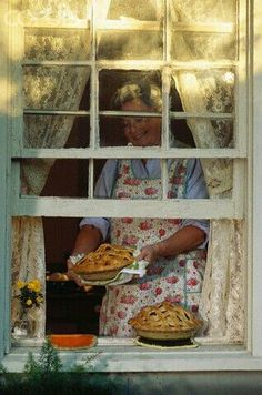 window with a view of grandma and her fresh baked apple pies