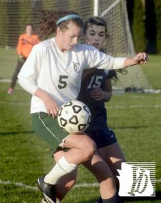 York Catholic's Natasha Vadas handles the ball with pressure from Kutztown's Kathryn Brooks during the District 3-A girls' soccer quarterfin...