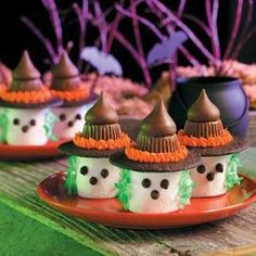 Halloween Treats, saw on FB food colored coconut strings for hair, marshmallows and chocolate chips for face, mini Reese's cups and a Hershey kiss on top of chocolate wafer for hat.