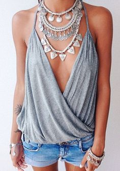 Model in grey surplice cami top with shorts and accessories