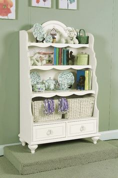 Beautiful bookcase for a girl's room -- add molding, trim, & legs to a plain bookcase
