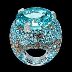 Temperatures are heating up in Bal Harbour, but de Grisogono is here to cool you down with this icy aquamarine cocktail ring! Composed in white gold with aquamarines and brown & white diamonds! http://balharbourshops.com/limited-edition-archives