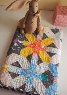 a baby quilt using Lotta Jansdotter's Mormor fabric line. and a really cute bunny model.