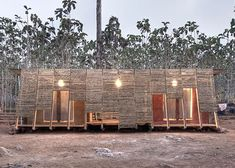 Norwegian architecture studio TYIN Tegnestue Arkitekter has designed a sanitary building and bathhouse for an orphanage in Thailand with a bamboo facade. Architecture Durable, Timber Architecture, Classical Architecture, Sustainable Architecture, Sustainable Design, Contemporary Architecture, Vernacular Architecture, Minimalist Architecture, School Architecture