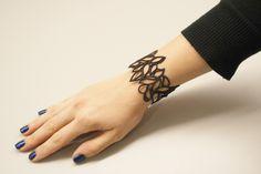 Bracelet by Batucada Jewels on the Skin. Made in Paris from eco-friendly synthetic rubber that's tough, seawater-resistant, and affordable. The Crocker Art Museum Store carries several styles that form delicate tattoo-like patterns on the skin. Great holiday gift idea!