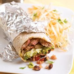 Here's a burrito inspired by San Francisco's super burritos that come packed with meat, beans, rice, cheese, guacamole and salsa. We've kept this home-style version a bit simpler to make and a whole lot healthier with brown rice, whole-wheat tortillas and a more reasonable serving size. We recommend wrapping it in foil--the traditional way to serve it--so you can pick the burrito up and eat it without it falling apart, peeling back the foil as you go. Serve with a cold beer and vi...