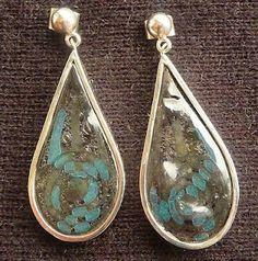 Lucia Palomeque: aretes de plata con conchas tornasol