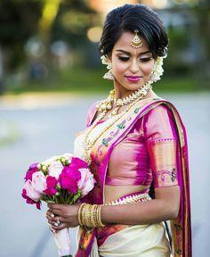 South Indian bride. Gold Indian bridal jewelry.Temple jewelry. Jhumkis. Cream white and pink silk kanchipuram sari .braid with fresh jasmine flowers. Tamil bride. Telugu bride. Kannada bride. Hindu bride. Malayalee bride.Kerala bride.South Indian wedding.