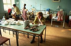 Looks more like the 1970s: Women patients sit at a table with food and fold their laundry in a rundown hospital ward in Moscow in July 1991. (1991!!!! That means this was in MY lifetime, and I'm only 22.)