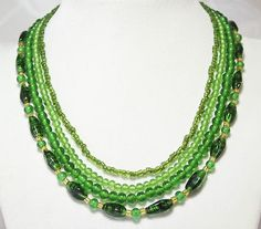 "ART DECO VINTAGE MULTI STRAND GREEN MURANO ITALIAN GLASS BEAD NECKLACE JEWELRY                            Seller information  justinsublime (1556  )      100% Positive feedback  Save this seller  See other items     AdChoice  Item condition:--  ""HAS SOME VERDIGRIS , NEEDS CLEANED ( SEE PHOTO )""  Time left: 5h 57m 57s (Feb 14, 2013 18:29:13 PST)  Current bid:US $63.00  [ 19 bids ]"