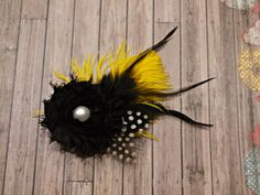 Yellow and black feather hair clip by stylesbym on Etsy, $10.00