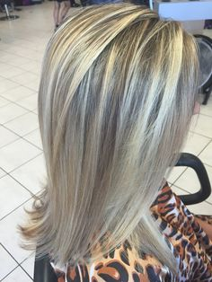 Heavily highlighted blonde hair. Layered haircut