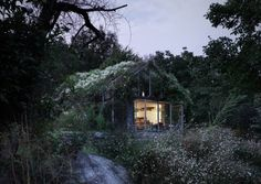 """Residential Architecture: Green Box by act_romegialli: """"..This glazed garden hideaway in Italy by Italian studio act_romegialli is disguised inside a dense thicket of bushy plants and blossoming wildflowers..The little building previously functioned as a garage for a weekend retreat in the Raethian Alps, butact_romegialliwas asked to convert it into a space where the owner can keep gardening tools, prepare meals and entertain guests..Retaining the rustic stone walls and columns of the old g..."""
