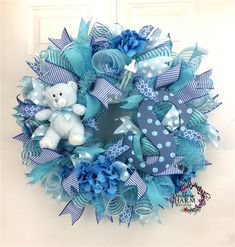 Custom ordered #baby boy wreath with bear and monogram. What a great way to display that your bundle of joy has arrived.