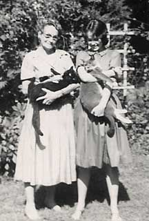 Sandy and Grandma Hopp with cats Gaby and Dusa. submitted by Pam Dennis