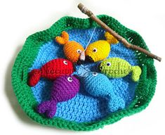 So I'm going to have to learn how to crochet now... drat. (Rainbow Fishing Game pattern by Nichole Cupp)
