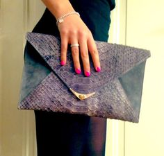 """One of """"The Snake"""" clutch family in a dark grey. Part of one of our favorite LIMITED stamped cowskin leathers - with (of course) a chain inside to wear on your shoulder! <3"""