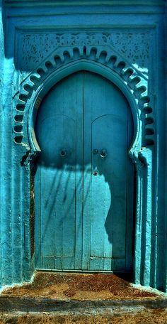 Turquoise Door  This effect could be done to any doorway really.  Just make your own wall paper and past it onto matching faux painting!