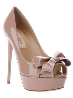 Beige patent leather pumps from Valentino featuring an open toe, a bow detail to the front, small cut-out panels at the sides, an exposed platform, a high stiletto heel and a leather sole.