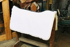 Engel Sheepskin Western Saddle Blanket Completely Lined White Western Saddle Blanket. 'Full Quilted' Saddle Pads combines the traditional look of a saddle blanket with the protection and supreme comfort of sheepskin. This top of the line Western saddle pad contours to the natural shape of the horses back. This Western Saddle Pad is completely lined […]