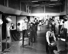 School of Photography – Charles Savage  and unidentified students in the photo  studios. Downtown campus