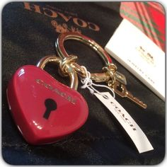 New Coach Keychain ❤️ Ruby Red and Gold Heart Coach Keychain. New with tags. Comes with Black and gold Dust Bag and Coach Paper Bag. Coach Accessories Key & Card Holders
