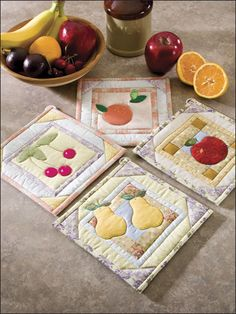 Luscious fresh-fruit appliques of cherries, pears, an apple and orange make this set of four pieced pot holders an appetizing addition to anyone's kitchen. This e-pattern was originally published in 101 Fun-to-Quilt Pot Holders. Size: x Skill Level: Easy Small Quilts, Mini Quilts, Quilted Potholders, Quilting Board, Quilted Gifts, Summer Quilts, Mug Rugs, Quilting Projects, Quilting Ideas