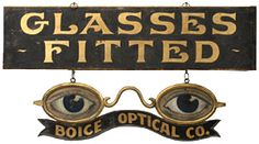 """There were seven phone bidders for this """"Glasses Fitted"""" optician trade sign, a single-sided wood sign with ornate gold-painted lettering on a black smalt (ground glass) background, beneath which hangs a finely crafted painted sheet zinc pair of spectacles, which are double-sided. It is among the finest examples of figural eyeglasses signs. Measuring 24½"""" x 46½"""" and in excellent condition, it sold in the salesroom for $12,650 (est. $2500/3500). Bill Powell collection."""