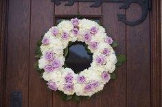 Fresh lavender rose and white hydrangea wedding wreath to decorate the ceremony location door.