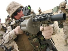 Staff Sgt. James C. Sanchez aims in with the M-32 Multiple shot Grenade Launcher, an experimental six-barreled weapn that can deliver six 40 mm grenades in under three seconds. Marines are fielding the new rapid-fire weapon to troops to boost small-team capabilities to deliver greater indirect firepower.