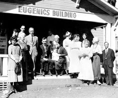 Winning family of the Fittest Family award stands outside of the Eugenics Building, 1925