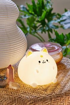 Kawaii-cute Shiro Cat light by Smoko, that brings a happy little glow to your nightstand or display shelf. Soft, silicone design that's so squishable. Turn it on and off with a gentle tap! Powered by rechargeable battery.