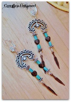 COWGIRL STYLE EARRINGS Copper Feather Charm on Antique Silver Chandelier Earrings #copper #copperjewelry #copperearrings #cowgirljewelry #cowgirlearrings #earrings #turquoisejewelry #turquoise #turquoiseearrings #jewelry #boho #cowgirl #rhinestoneearrings #rhinestonejewelry #rhinestone #silverjewelry #Heart