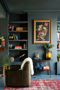 The 60s ceramic jug is from a Berlin flea market; the vintage rug from allthehues.co.uk Walls in Farrow & Ball Down Pipe