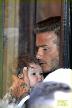 """David Beckham carries his adorable sleeping daughter Harper at the Victoria Beckham fashion show on Sunday (February 12) at the New York Public Library in New York City.    Victoria, 37, debuted her new fashion line for New York Fashion Week, and even named one of her new handbags after baby Harper!"""