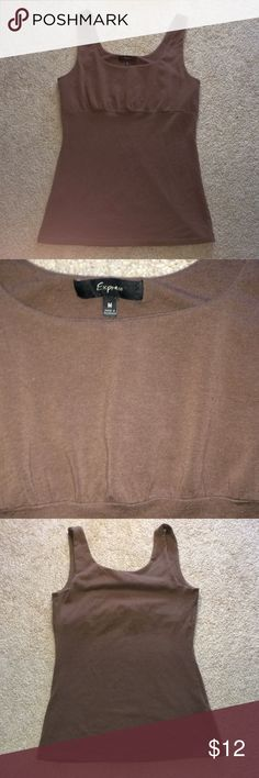 Express light brown tank with shelf bra, size M Express light brown, stretchy tank with built in shelf bra, size M. Very fitted. I layered this under looser tops. GUC. Make me an offer!! Express Tops Tank Tops