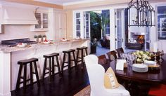 Barclay Butera Interior Design - Town and Country - Los Angeles Interior Designer, Newport Beach Interior Designer, Park City Interior Designer, New York Interior Designer - White Kitchen, Kitchen Bar, Bar Stools, Mix match dinning table, French doors,