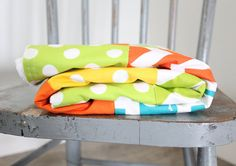 This listing is for a patchwork blanket - Patchwork Blanket - 34 x 44 backed with white minky - mix of turquoise, lime green, yellow,orange and Patchwork Blanket, Patchwork Baby, Bright Nursery, Giraffe, Elephant, Crib Blanket, Orange, Yellow, Cribs