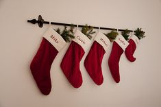 Stockings hung from a rod and Command hooks...I may try with picture frames after the holidays!