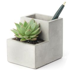 [ $20.39 ] CONCRETE DESKTOP PLANTER AND PEN HOLDER. Create a little green personal space on your desk with the Concrete Desktop Planter and Pen Holder from Kikkerland. The mini concrete planter will house a small plant and your pens in one functional but stylish design. It is well documented that plants help to absorb toxins in the air emitted by computers. Filling the Concrete Desktop Planter will enhance your workspace, improve your air quality and give you an opportunity to talk and…