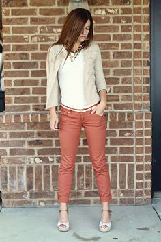 dark coral pants with a white shirt and cream cardigan