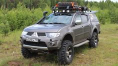 Quite a nice L200 with a lift kit and light bar on a roof rack